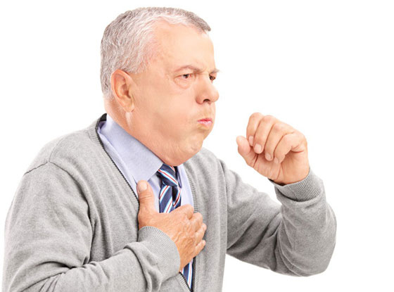 A mature gentleman coughing because of pulmonary disease