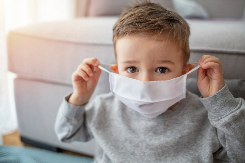 little-boy-wearing-anti-virus-mask-staying-at-home-picture-id1214761437_d_850